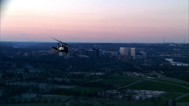 a helicopter flies over the pentagon. - united states department of defense stock videos & royalty-free footage