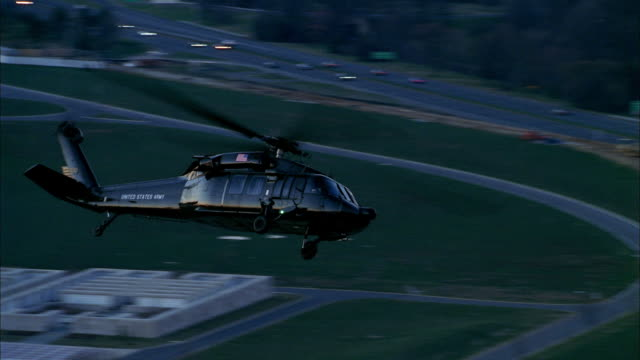 a helicopter flies over the pentagon. - department of defense stock videos & royalty-free footage