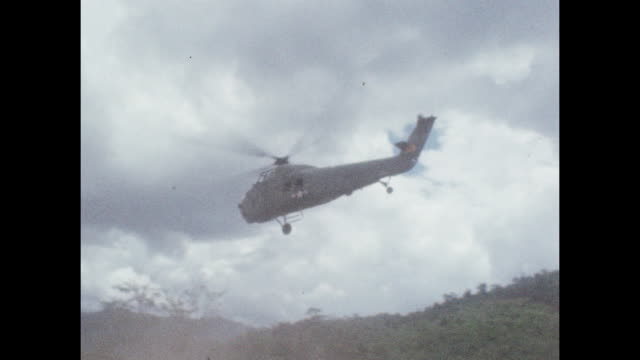 helicopter flies overhead during the vietnam war in combat zone near the 17th parallel. - helicopter stock videos & royalty-free footage
