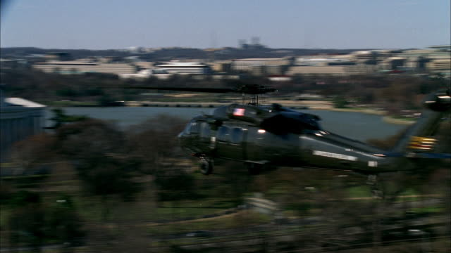 a helicopter flies past the jefferson memorial near the potomac river in washington, d.c. - jefferson memorial stock videos & royalty-free footage