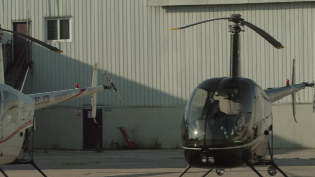 LS PAN helicopter flight line in front of hangars, RED R3D 4K
