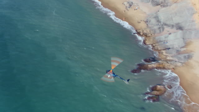 aerial helicopter flying above a shoreline - helicopter stock videos & royalty-free footage