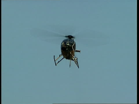 ms, la, helicopter flying against clear sky, costa mesa, california, usa - costa mesa stock videos & royalty-free footage