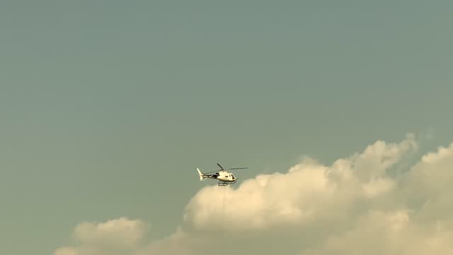 helicopter flying against sky and clouds - high up stock videos & royalty-free footage