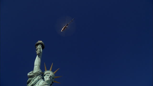TS Helicopter flying around the Statue of Liberty / New York City, New York, United States