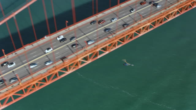 aerial helicopter flying below the golden gate bridge in san francisco, ca in sunshine - traffic stock videos & royalty-free footage
