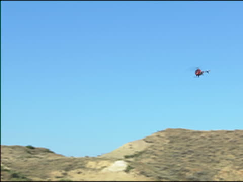 helicopter flying over badlands / hell creek, montana - badlands stock videos & royalty-free footage