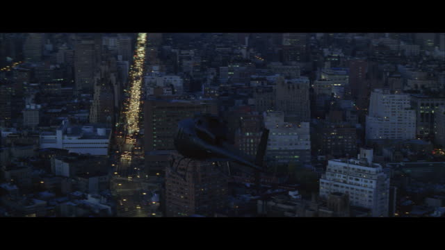 air to air, helicopter flying over city at dusk, new york city, new york, usa - レターボックス点の映像素材/bロール
