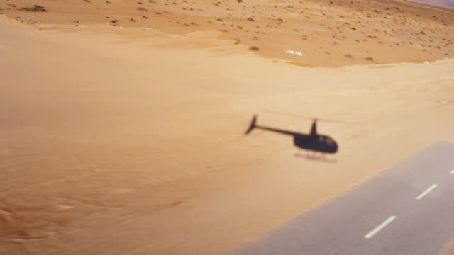 ws helicopter pov flying over deadvlei desert,namibia,africa - helicopter stock videos & royalty-free footage