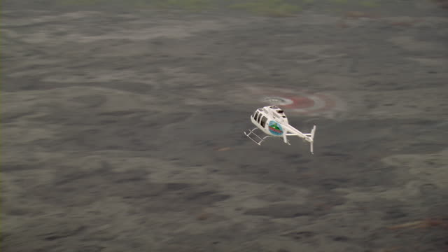 helicopter flying over lava flow on the pacific ocean. - big island hawaii islands stock videos & royalty-free footage