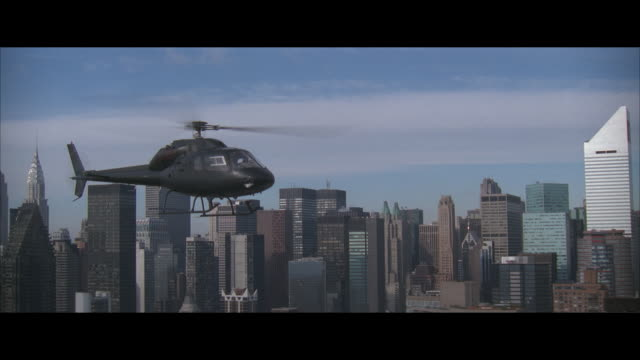 air to air, helicopter flying over manhattan, new york city, new york, usa - helicopter stock videos and b-roll footage