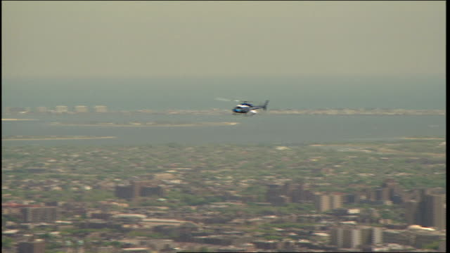 helicopter flying over nyc as seen from atop wtc - 1999 stock videos & royalty-free footage