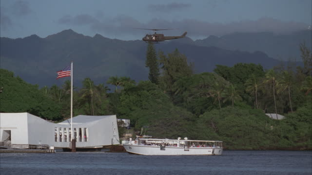 ws, pan helicopter flying over pearl harbor, hawaii, usa - pearl harbor stock videos and b-roll footage