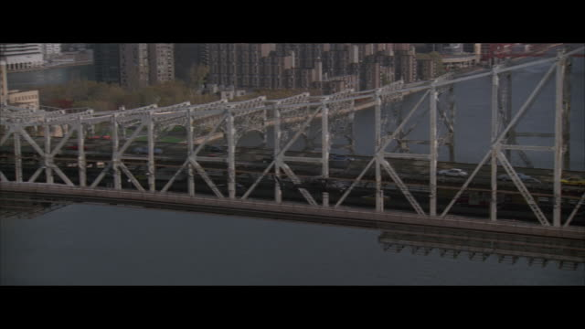 air to air, helicopter flying over queensboro bridge new york city, new york, usa - レターボックス点の映像素材/bロール