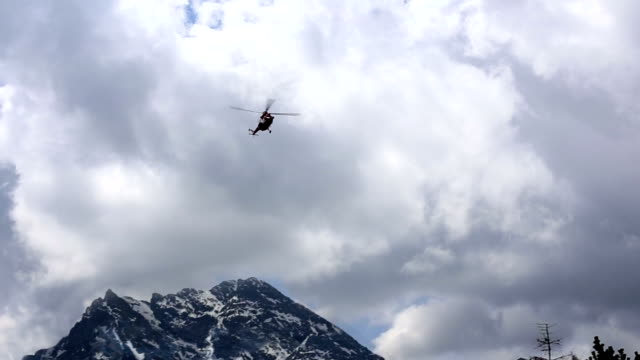 Helicopter flying over Tatra Mountains