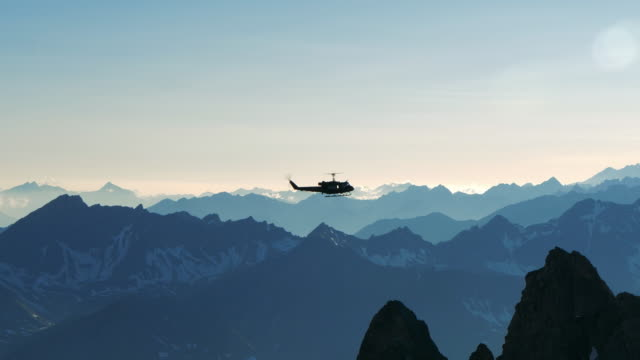 helicopter flying over the mountains - elicottero video stock e b–roll
