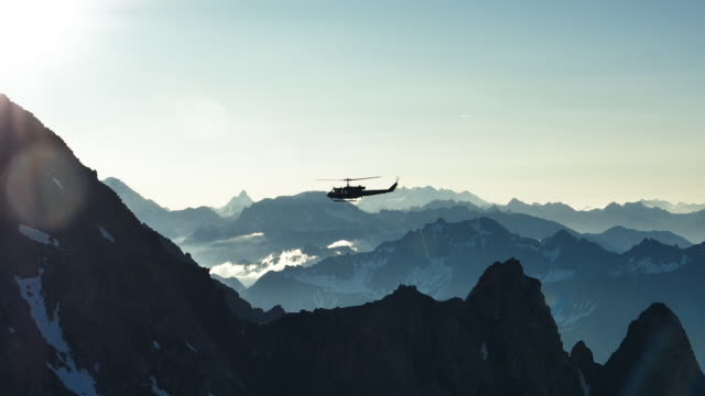 helicopter flying over the mountains - helicopter stock videos & royalty-free footage