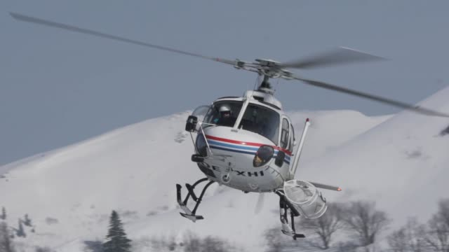 helicopter flying skiers up mountain - helicopter tour stock videos and b-roll footage