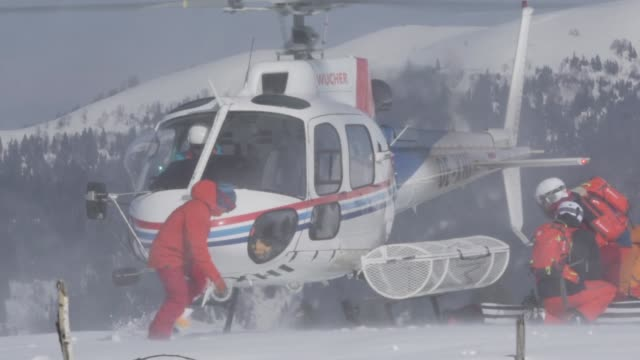 Helicopter flying skiers up mountain