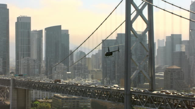 aerial helicopter flying towards san francisco financial district in sunshine - cantilever bridge stock videos & royalty-free footage