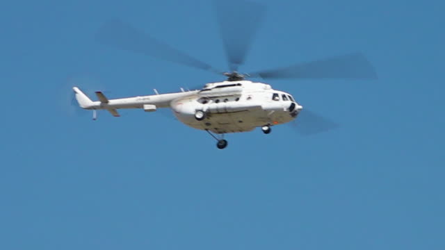 a helicopter flying - helicopter landing stock videos & royalty-free footage