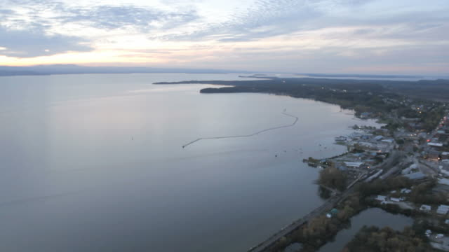 Helicopter footage of Lake Champlain – facing out towards the lake towards mountains in NY.