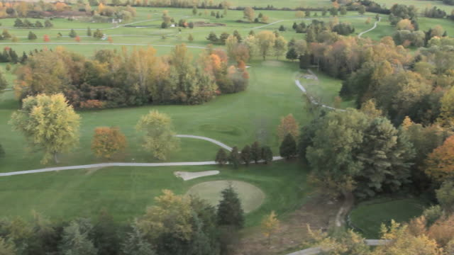 helicopter footage over golf course in fall in vermont. - burlington vermont stock videos & royalty-free footage