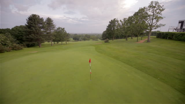 helicopter golf hole rise - green golf course stock videos and b-roll footage