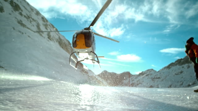 slo mo ld helicopter hovering above the icy ground - helicopter stock videos and b-roll footage