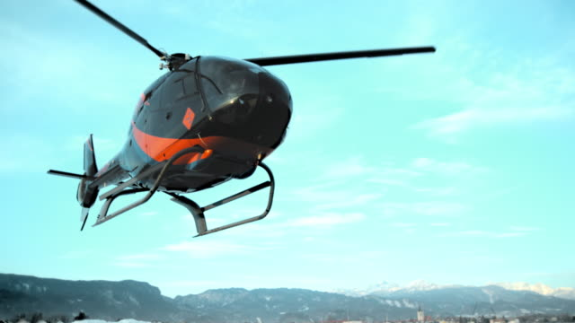 slo mo ld helicopter hovering right above the ground - helicopter stock videos and b-roll footage