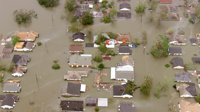 helicopter hovering through flooded area to rescue survivors / united states - new orleans stock videos & royalty-free footage