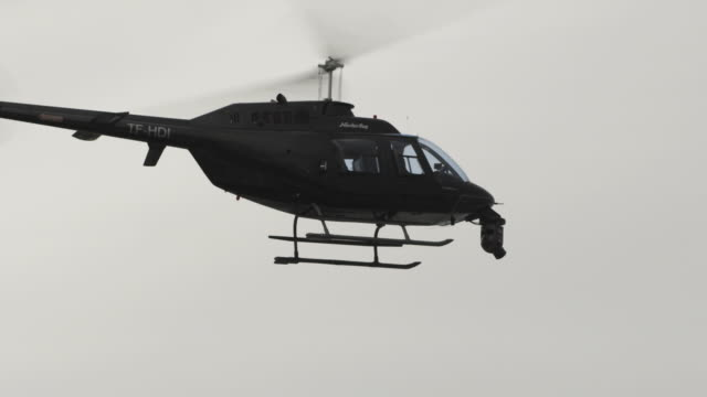 A helicopter hovers in the air.