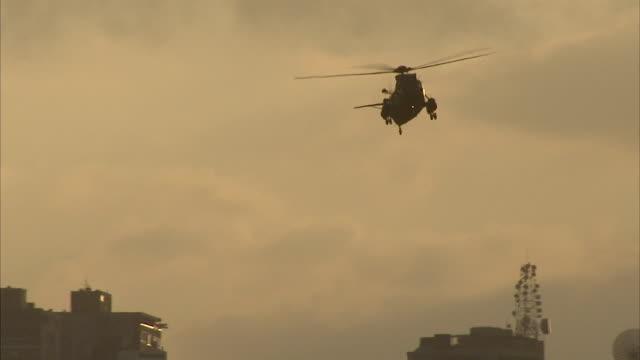 WS PAN Helicopter in dusky, hazy sky over Caracas / Metropolitan District of Caracas, Miranda, Venezuela
