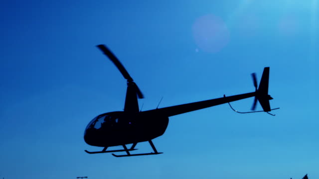 helicopter in flight - hovering stock videos & royalty-free footage