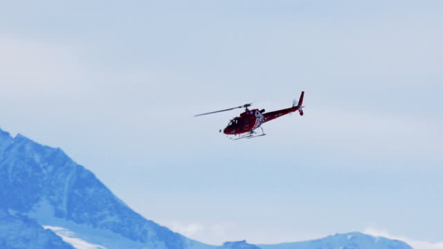 helicopter in winter mountains - helicopter stock videos and b-roll footage