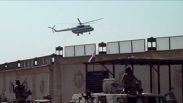 a helicopter is seen arriving at tora prison thursday and soon after departing with egypts ousted president hosni mubarak to a military hospital... - prison release stock videos & royalty-free footage