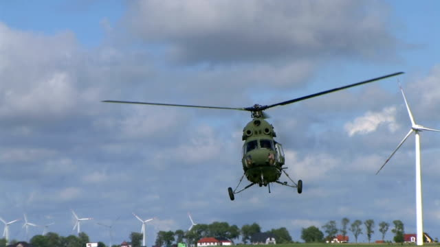 helicopter landing against wind turbines - helicopter landing stock videos & royalty-free footage