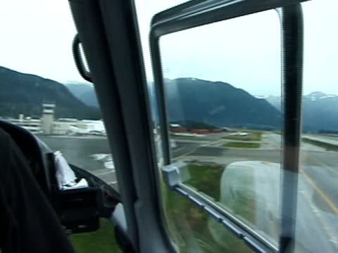 helicopter landing at airport: cockpit view - helicopter landing stock videos & royalty-free footage
