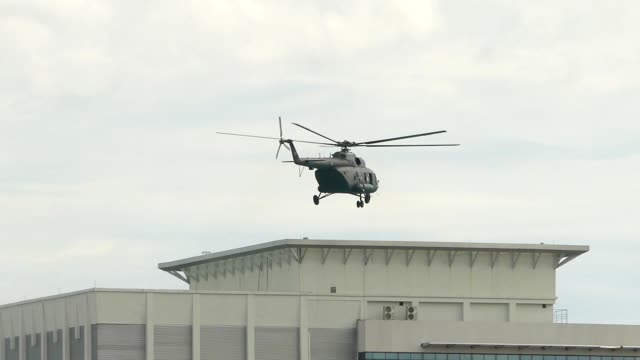 helicopter landing on building roof - landing touching down stock videos & royalty-free footage