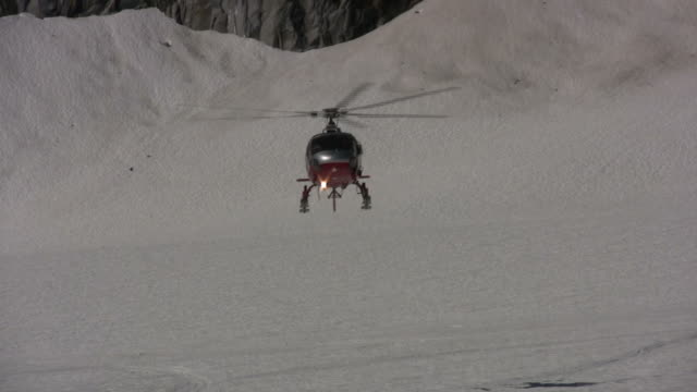 helicopter landing on glacier - helicopter landing stock videos & royalty-free footage