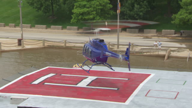 aerial ms helicopter landing on halipad / st louis, missouri, united states - helicopter landing stock videos and b-roll footage