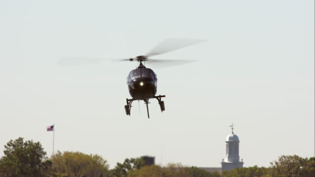 helicopter landing on helipad in front of governors island in new york city - ヘリポート点の映像素材/bロール