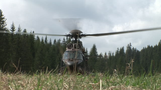 hd: helicopter landing - military helicopter stock videos & royalty-free footage