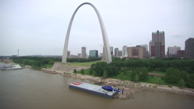 aerial ws ts helicopter moving near gateway arch and landing on boat / st louis, missouri, united states  - jefferson national expansion memorial park stock videos & royalty-free footage