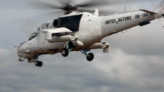 helicopter of united nations forces in sky of liberia - 平和維持点の映像素材/bロール
