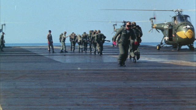 ms helicopter on airplane carrier deck, marines board helicopter and taking off - flugzeugträger stock-videos und b-roll-filmmaterial