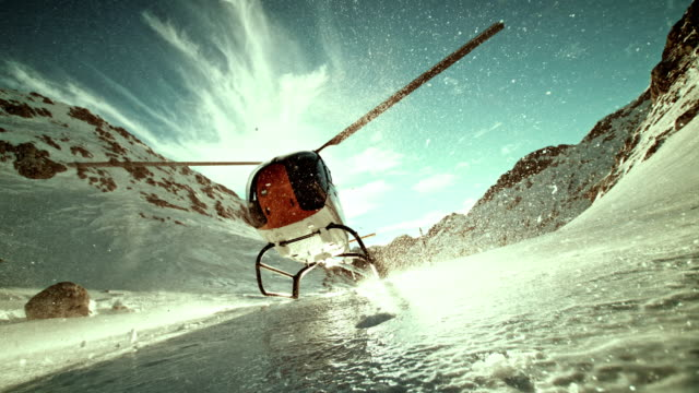 slo mo ld helicopter on top of the icy mountain - helicopter stock videos & royalty-free footage