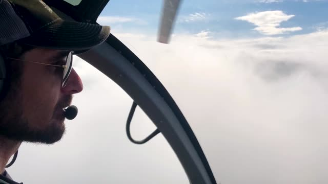 a helicopter passes above volcanic gases mixed with smoke rising from fires caused by lava in the leilani estates neighborhood in the aftermath of... - evacuation stock videos & royalty-free footage