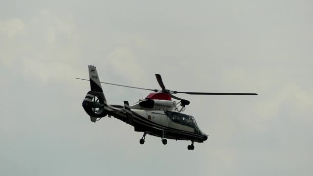 helicopter passing the sky - helicopter stock videos & royalty-free footage
