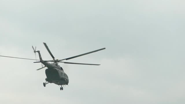 helicopter passing the sky - terrorism stock videos and b-roll footage